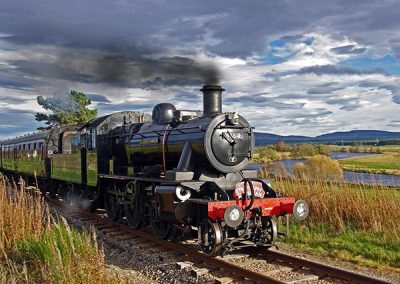 Ivatt 46512 travels alongside the river Spey